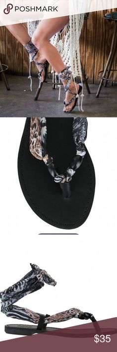 "MIA | Drina Scarfs Wrap Sandals New without box   We have great news! The Drina Scarf Wrap Sandals are going to match the black cover up you just packed for Bimini. Yes flip flops are nice and comfortable, but we have to show off your fashion sense with a little more pizazz. The sole of the sandal is black with an intriguing white & black snake scarf fabric that wraps around the ankle. The print is fun, exotic and will definitely look amazing on you.   Padded Insole Fabric Wrap Up Heel: 0.4""…"