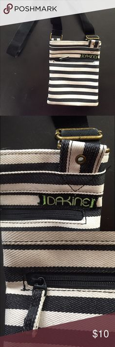 ❄️SALE!❄️ Dakine over shoulder sporty purse Dakine over the shoulder sporty purse. Adjustable strap, dark denim blue and white striped. In perfect condition, and a very comfortable useful purse! Dakine Bags Crossbody Bags