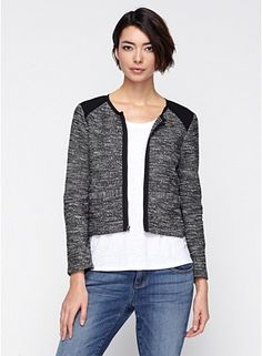 Short Jacket with Ponte Panels in Tweedy Knitted Cotton A new twist on tweed. In a knitted cotton jacket with color-blocked details.      Ponte panels at the shoulders, sleeves and sides.     2-way metal zip with grosgrain tape, front welt pockets.     Round neckline, bracelet sleeves with zipper detail.     A textural, two-tone knit that loves to be tailored. It's structure that understands comfort.     Viscose Stretch Ponte is an Italian doubleknit we use for architectural shapes.
