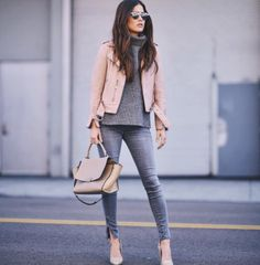 Layered with a turtleneck sweater, jeans, nude pumps, and a satchel bag.
