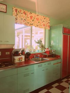 red-kitchen-counter-tops.  The cottage of my childhood has red linoleum counters with steel bands at the edges.  They were so cool!