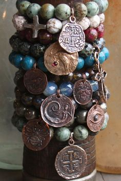 bracelets with birds, the all seeing eye, mermaids, crosses and bees.....