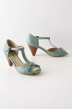these heels are adorable! And I love the color.
