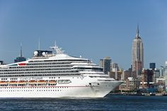 The Carnival Triumph cruise ship sails down the Hudson River past New York City's Empire State Building.  All images available for licensing as high-resolution TIFF or RAW files. Contact dj@denniskjohnson.com     http://djpresskits.com/