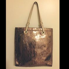 Large Copper Color MK Bag Beautiful large copper colored authentic Michael Kors bag with beige handles and gold hardware. Used once or twice but was a little too large for my taste. Perfect condition. Michael Kors Bags Totes