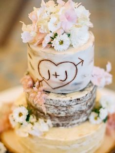 """Utterly romantic rustic tree trunk wedding cake with the bride and groom's initials """"carved"""" in the side 