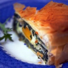 This simplified version of Torta Pasqualina, the traditional Italian Easter pie from Liguria, is made with spinach and ricotta, poached eggs and crunchy filo pastry.