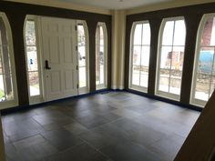 Natural Pattern Cut Full Color Flagstone set on concrete flooring for a new Foyer addition Bluestone Pavers, Step Treads, Sandstone Wall, Natural Stone Veneer, Landscape Maintenance, Landscape Materials, Outdoor Areas, Concrete Floors, Foyer