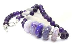 Gorgeous!  This is a beautiful chunky necklace.  I've used 10mm amethyst beads, 20-24mm purple variegated agates discs and 7mm sterling silver accent beads.  It's beautifully finished with Bali silver