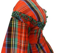 Plaid was fashionable during the mid-19th century thanks in part to the influence of Queen Victoria's love of Scotland and Balmoral. The bright colors of this 1860s example are likely from the new chemical dyes invented shortly before. I could see my fashionable minor character Eliza wearing such a dress.