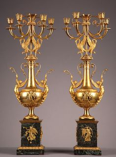 Pair of gilded and chiselled bronze four-light candelabra with vase-shaped stem decorated with winged women and Cupids, surmounted by two ibis. Nozzle finely adorned with openwork foliages a