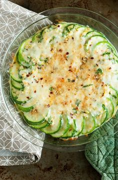 Zucchini au Gratin: Sliced zucchini rounds topped with freshly grated cheddar and fontina cheeses and baked to bubbly perfection! Easy + cheesy!