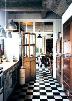 black + white floor tile* rustic rich wood* beautiful contrast* pendant lighting*