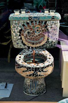 mosaic toilet?  http://www.lawrencerestore.org/upcycle-07-toilet.jpg