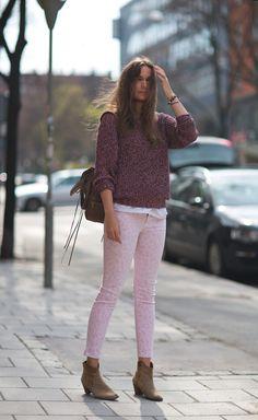 Caroline Blomst in Current & Elliott cropped pastel pink animal print jeans.