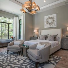 So elegant! Love a sitting area in a master bedroom! By Masterpiece Design Group