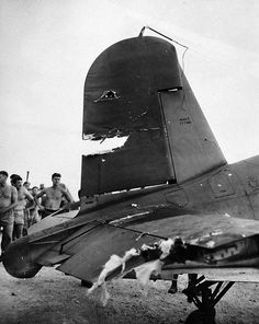 80-G-207855: A damaged F4U back at its base after a fight with two Japanese Zeros over New Britain, January 12, 1944. U.S. Navy Photograph, now in the collections of the National Archives.