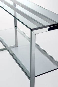 Hi square, Console with transparent glass top and structure in bright stainless steel.