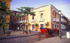 """#Cartagena, Colombia. This is surely the most beautiful colonial city in the Caribbean, its grandeur recognised by its designation as a Unesco World Heritage Site. Every street is a picture-postcard image, with buildings painted in vivid yellows, pinks and cerulean blues. The romance of the place is inescapable...  """"The telegraph"""""""