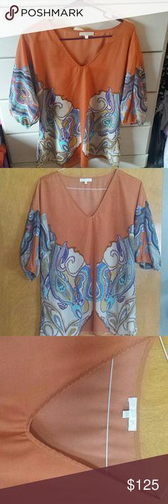 Glam top Beautiful nwot had to have it lol sitting in my closet great steal ...... great with anything ....great brand glam ...... glam Tops Blouses