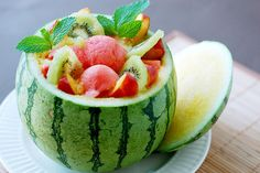 fruit filled watermelon topped with mint