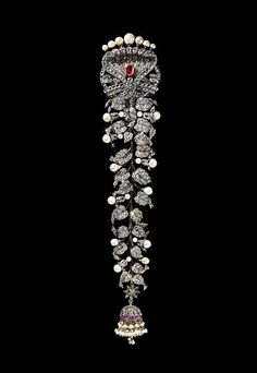 Plait Ornament (jadanagam) Object Name: Hair plait ornament Date: 1890–1910 Geography: South India Medium: Silver, set with diamonds, rubies, and pearls Dimensions: H. 12 1/4 in. (31 cm) W. 2 5/8 in. (6.6 cm) Classification: Jewelry Credit Line: The Al-Thani Collection