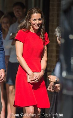 This morning, William and Kate were out and about again on a visit to YoungMinds in London. The event was embargoed, likely because of the sensitive nature of the charity's work. YoungMinds runs a helpline for young people suffering from mental health issues. The organization is one of the charities that has partnered with William, Kate, and Harry's Heads Together initiative. This is LK Bennett's Eugenia dress in red. Notice the beautiful tailoring along the shoulders, waist, and skirt.