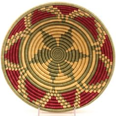Africa | Sisal Bowl from Rwanda | These baskets are coil woven using native grasses on the inside with fine sisal fiber or sometimes raffia on the outside of the coil.