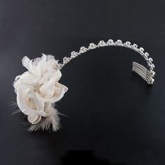 Silk Flower Headband with Feather - Various textures and details - silk, feather and crystal accents - come together for a unique wedding style.  Assembled in USA.