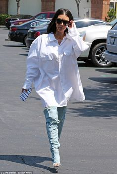 Kim Kardashian drowns her figure in oversize shirt as she goes to the movies with rapper and daughter North | Daily Mail Online