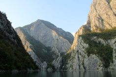 Hiking in Albania's Accursed Mountains : Limestone gorges on Lake Koman seen from the ferry. Image by Tom Masters / Lonely Planet Visit Albania, Places In Europe, Lonely Planet, Backpacking, The Good Place, Planets, Hiking, Masters, Mountains