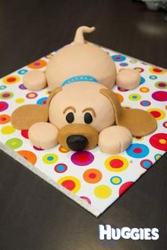 Puppy dog cake covered in fondant with colours to match our Labrador.