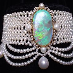 Woven seed pearl choker with elegant graduated pearl drapes and large antique opal brooch