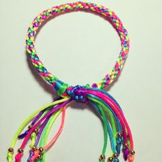 Kumihimo friendship bracelet with some beads on the ends