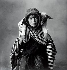 """IRVING PENN, """"Young Berber Shepherdess, Morocco 1971"""". Signed Irving Penn and dated 1983 on verso. Also stamped """"Photograph by Irving Penn copyright 1974 by Irving Penn Courtesy of Vogue"""" on verso. Selenium toned gelatin silver print, image 39.5 x 38.2 cm. Sheet 40.5 x 50.5 cm. Edition 32."""