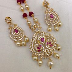 CZ and Ruby pendant with pearl drops and earrings Code : PS 398 Price: Rps. 1395/- Whatsap to 09581193795 for order processing