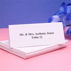 simple and white placecards are perfect for assigning seats each white place card has beveled