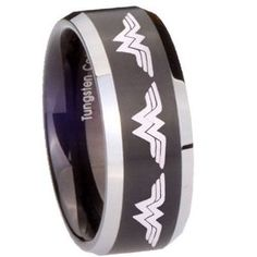 Wonder woman ring with the groom wearing a Batman ring. Love it!
