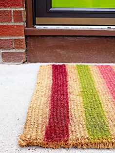 Add your personal touch to a store-bought door mat! More outdoor decorating projects: http://www.bhg.com/home-improvement/porch/outdoor-rooms/outdoor-decorating-projects/?socsrc=bhgpin060213doormat=13