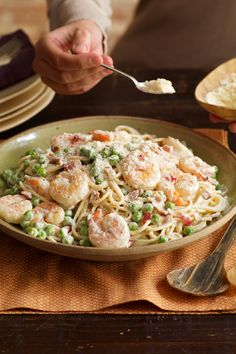 Shrimp Carbonara – The best Italian place in town? Your kitchen. In 25 minutes, you've got a classic pasta recipe that combines savory bacon with tasty shrimp and peas in a creamy sauce. Buon appetito!