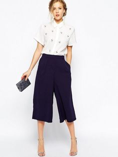 Back #culottes and white #blouse: a perfect match! Discover more items and download the app on www.fashionlook.co