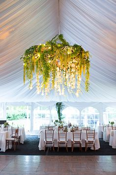 Luxe Reception Ideas - We can't stop obsessing over this non-traditional chandelier.