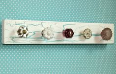 Awesome accessory hanger made with scrap wood and upcycled drawer knobs! Im so making and putting this in my craft room!