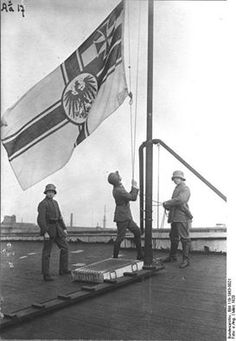 German Freikorps soldiers raise the Old Imperial Flag during the Kapp Putsch. March 1920.