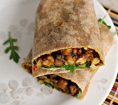 West Indian-Style Channa Wrap If you're not a big fan of spicy food you can turn down the heat in this West Indian recipe by omitting the chili pepper and using a mild curry powder. Wrap Recipes, Veggie Recipes, Indian Food Recipes, Vegetarian Recipes, Healthy Recipes, Healthy Cooking, Cooking Recipes, Trini Food, Vegan Wraps