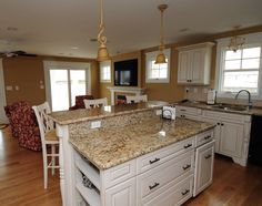 White Kitchen Cabinets, Wooden Floor, and Granite Countertops