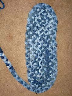 Frugal Veggie Mama: The Braided Denim Rug Tutorial  Could be adapted to use Hubby's threadbare white tshirts (dyed)?