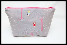 """Cosmetic bag w/ pocket - instead of using 3 pieces of fabric for the front, I used one 11 x 9 (since all I had were 12"""" zippers). It's still a great size. Great detail on the zipper ends."""