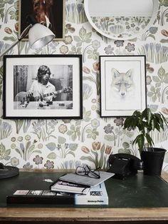 Floral wallpaper in home office with small gallery wall