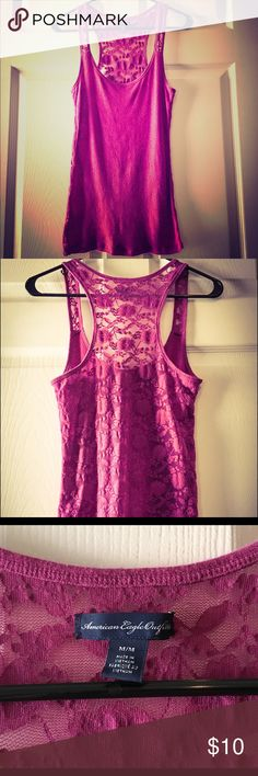 American Eagle racerback tank top with lace back Tank top from American Eagle in a beautiful magenta (purplish pink) color. The back is made from all lace. Previously loved and in great condition with lots of life left, and no apparent flaws! 10% of proceeds go to a local nonprofit organization! Our current charity focus is the One Orlando fund. American Eagle Outfitters Tops Tank Tops